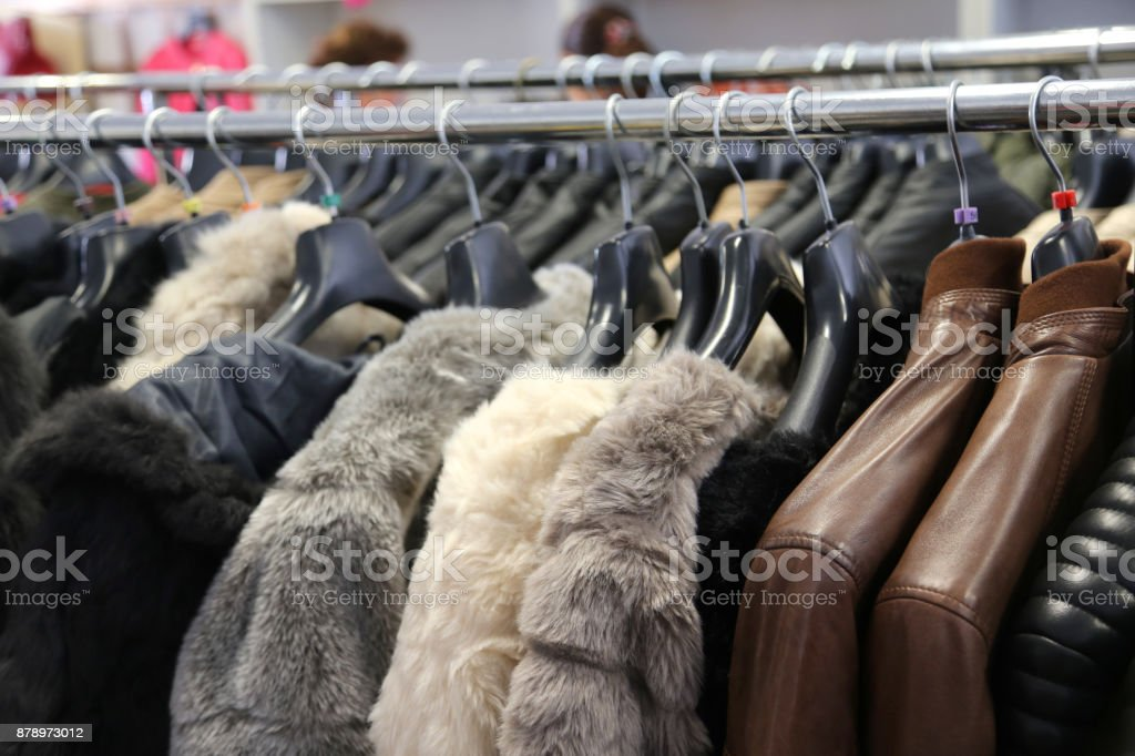 fur and leather outfits for sale in the boutique stock photo