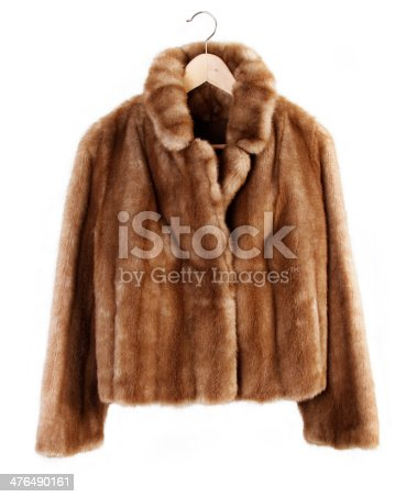 Fur coat on hanger isolated on plain background