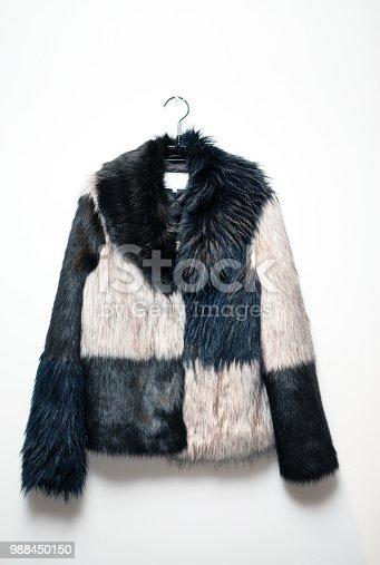 Black white fur coat jacket on hanger
