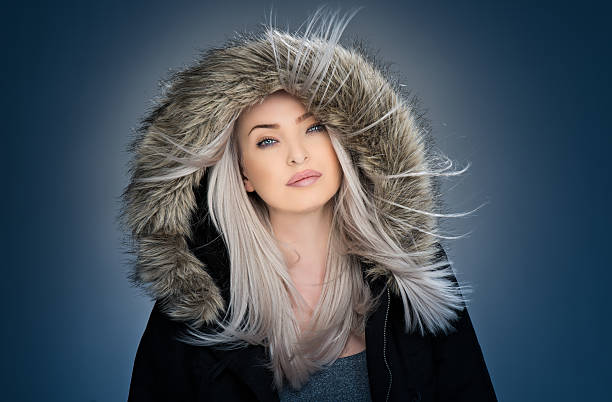 Fur Fashion. Beautiful Girl in Fur Hat. Winter Woman Portrait stock photo