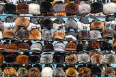 A variety of winter fur hats.