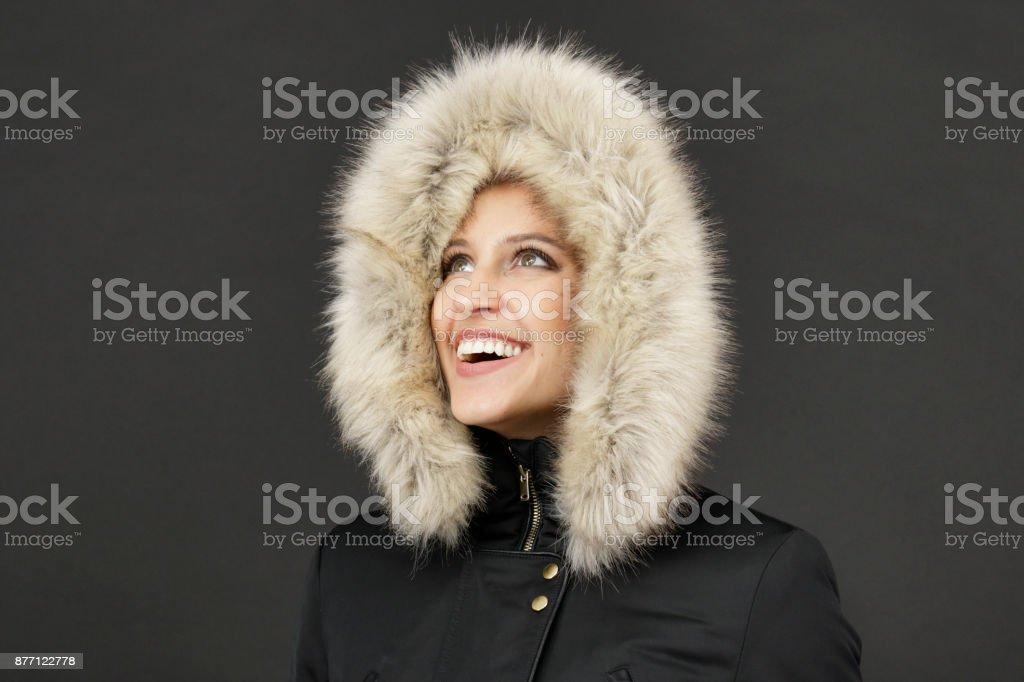 Fur hood framing face of smiling Russian indoor girl - Foto stock royalty-free di Adulto