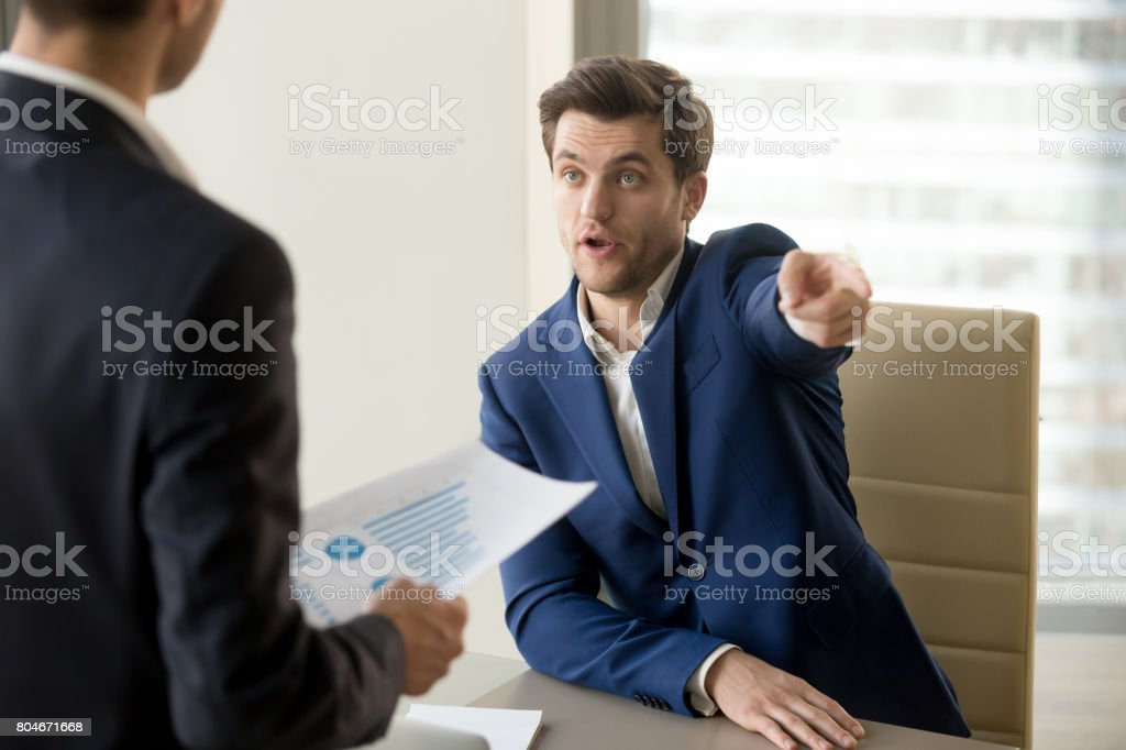 Furious boss firing incompetent employee, dissatisfied with bad work result stock photo
