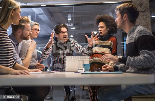 istock Furious boss shouting at his team on a meeting in the office. 921903204
