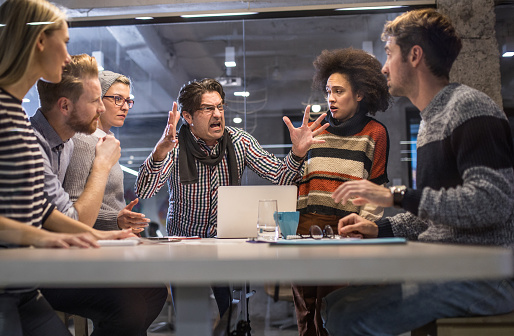 Furious Boss Shouting At His Team On A Meeting In The Office Stock Photo - Download Image Now