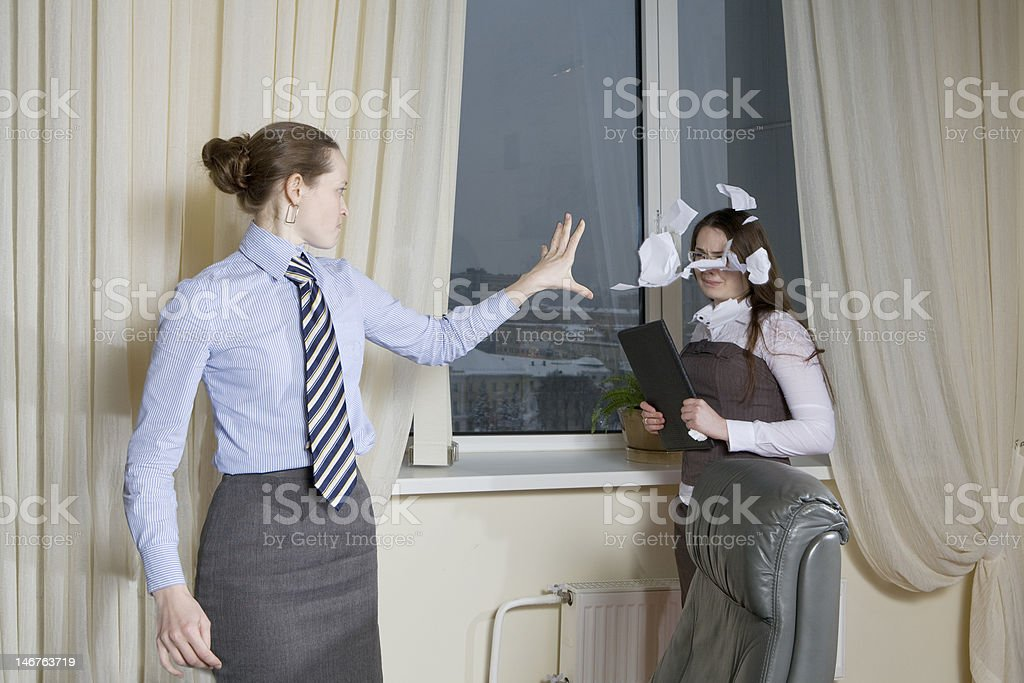 furious boss throws piece of paper royalty-free stock photo