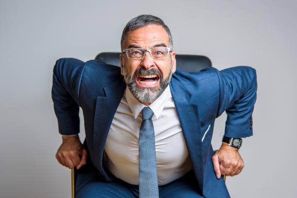 Furious business man stock photo