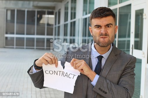 656916072istockphoto Furious businessman breaking a contract 925481478