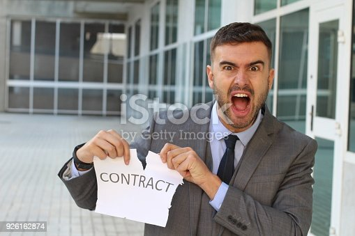 656916072istockphoto Furious businessman breaking a contract 926162874