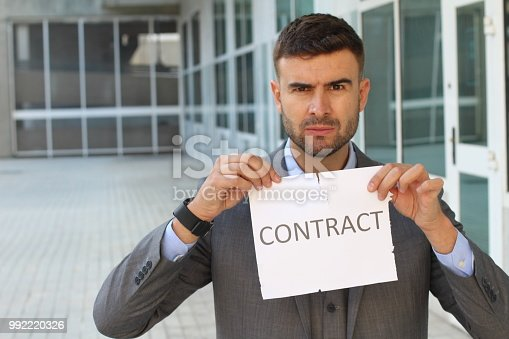 656916072istockphoto Furious businessman breaking a contract 992220326
