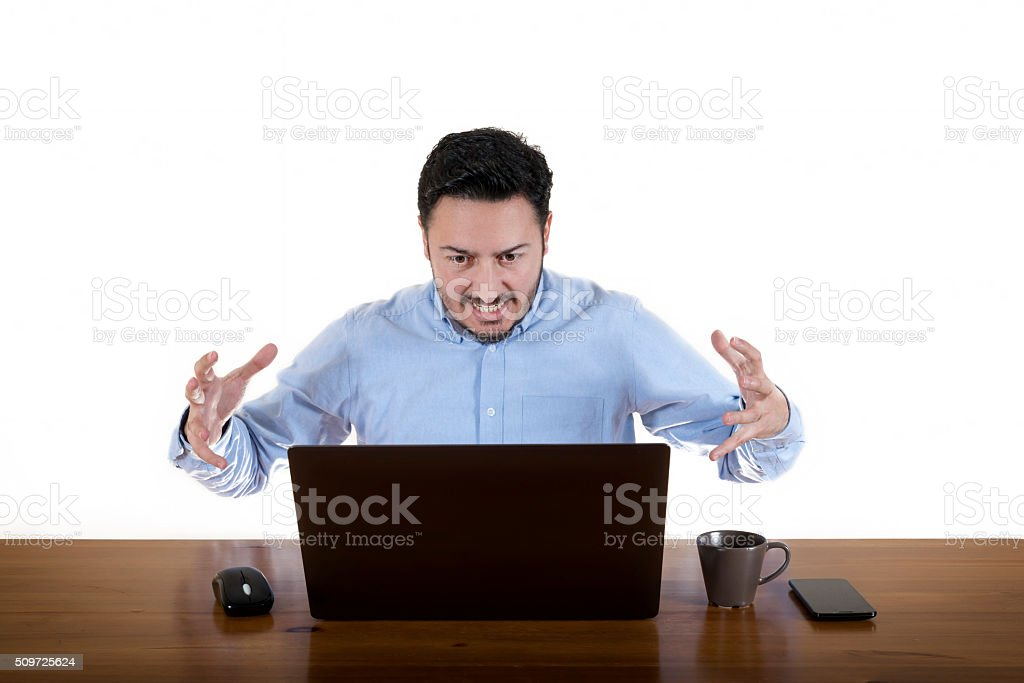 Furious Businessman Looking At Laptop Screen stock photo