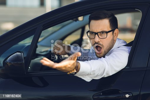 Angry businessman yelling out car window