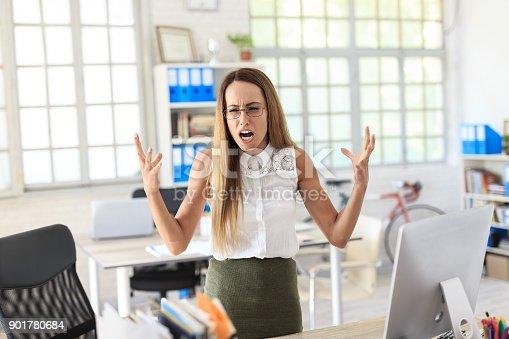 istock Furious businesswoman shouting at work 901780684