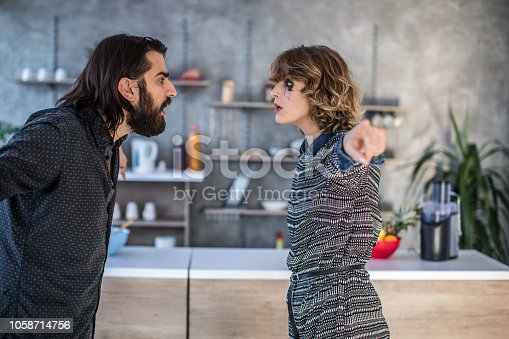 istock Furious couple arguing in the kitchen 1058714756