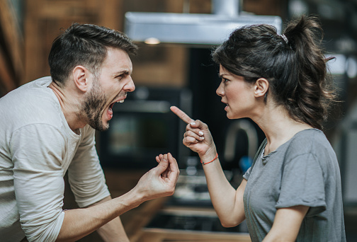 istock Furious couple arguing while having problems in their relationship. 950599040