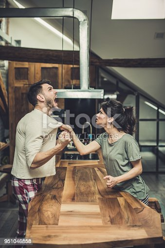 istock Furious couple fighting while having problems in their relationship. 951046858