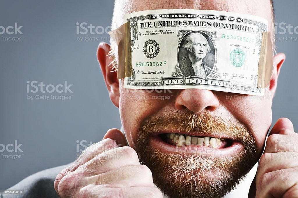 Furious frustrated businessman in US dollar bill blindfold stock photo