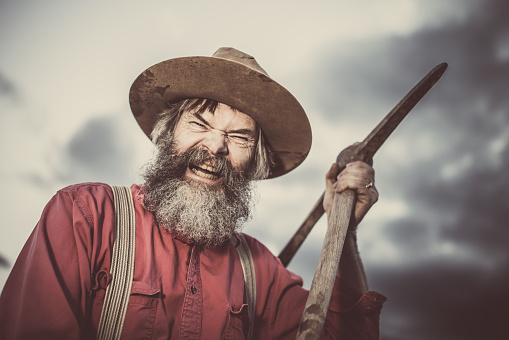 Furious Gold Miner With Pickaxe Stock Photo - Download Image Now