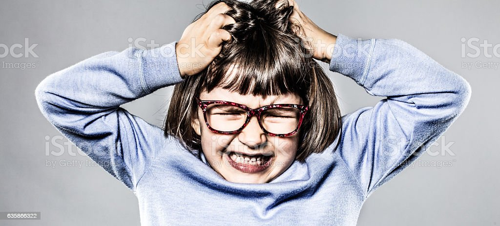 furious kid having tantrum, scratching head for anger and frustration stock photo