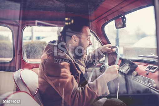 istock Furious Male Driving Fast with Old Style Car and Screaming 926944042
