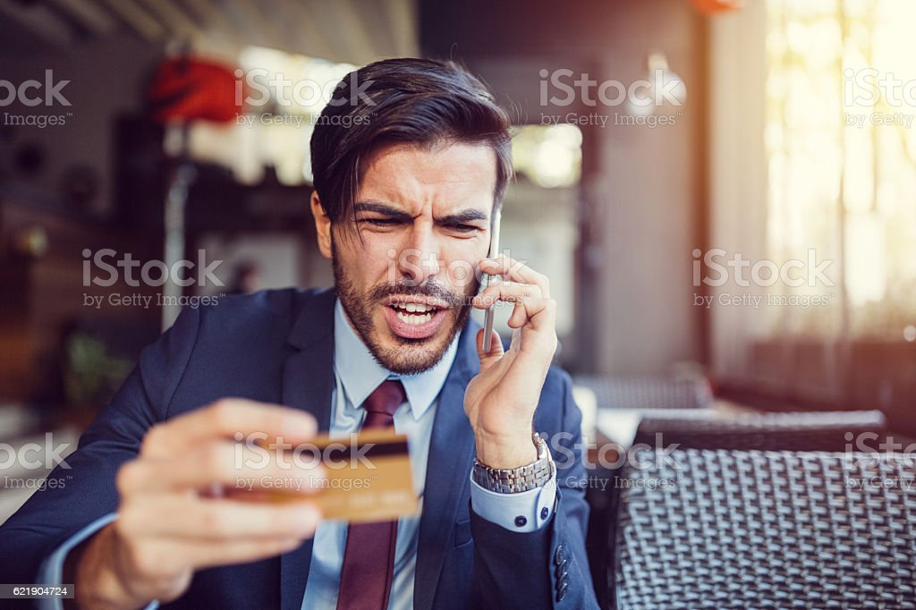 Furious man with empty credit card stock photo