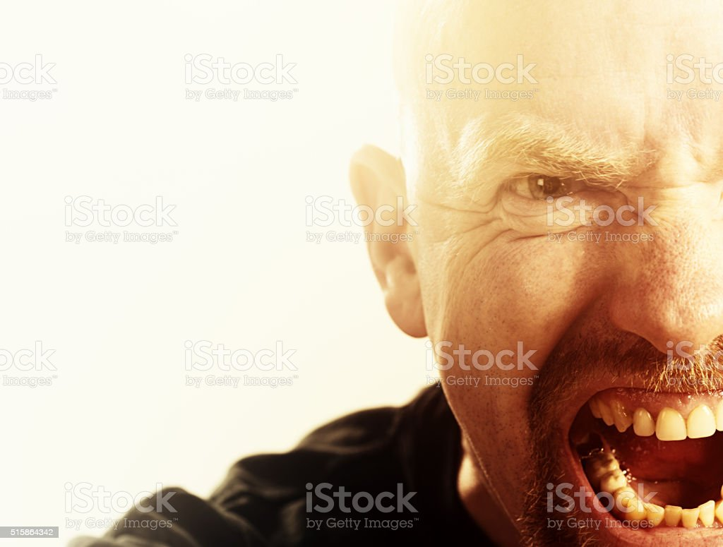 Furious man yells, out of control or insane stock photo