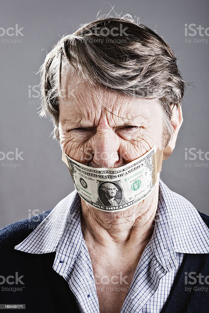 Furious old woman grimaces about dollar bill gag stock photo