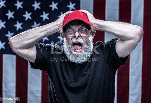 istock Furious Paranoid Partisan Alt-Right Republican Voter 883367832