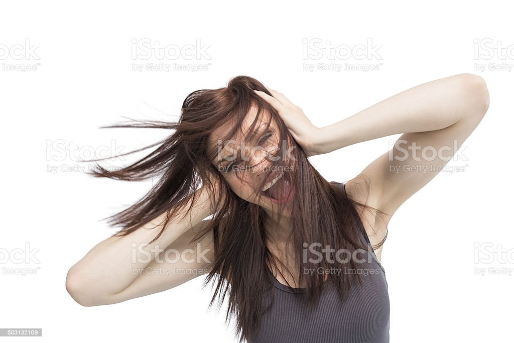 Furious pretty brunette shouting stock photo