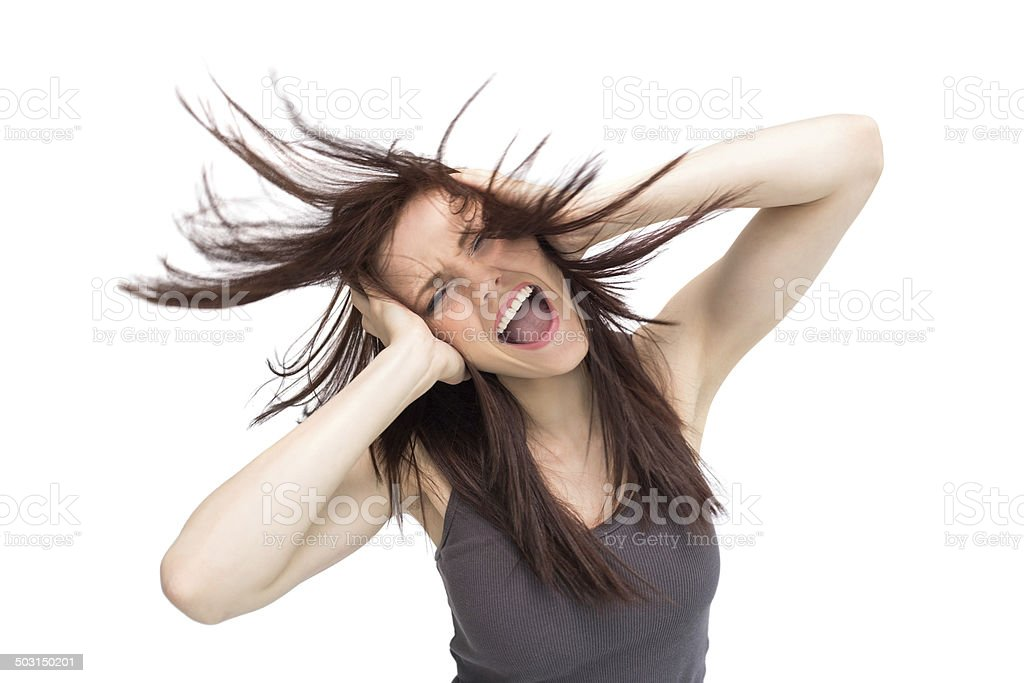 Furious pretty brunette tossing her hair stock photo