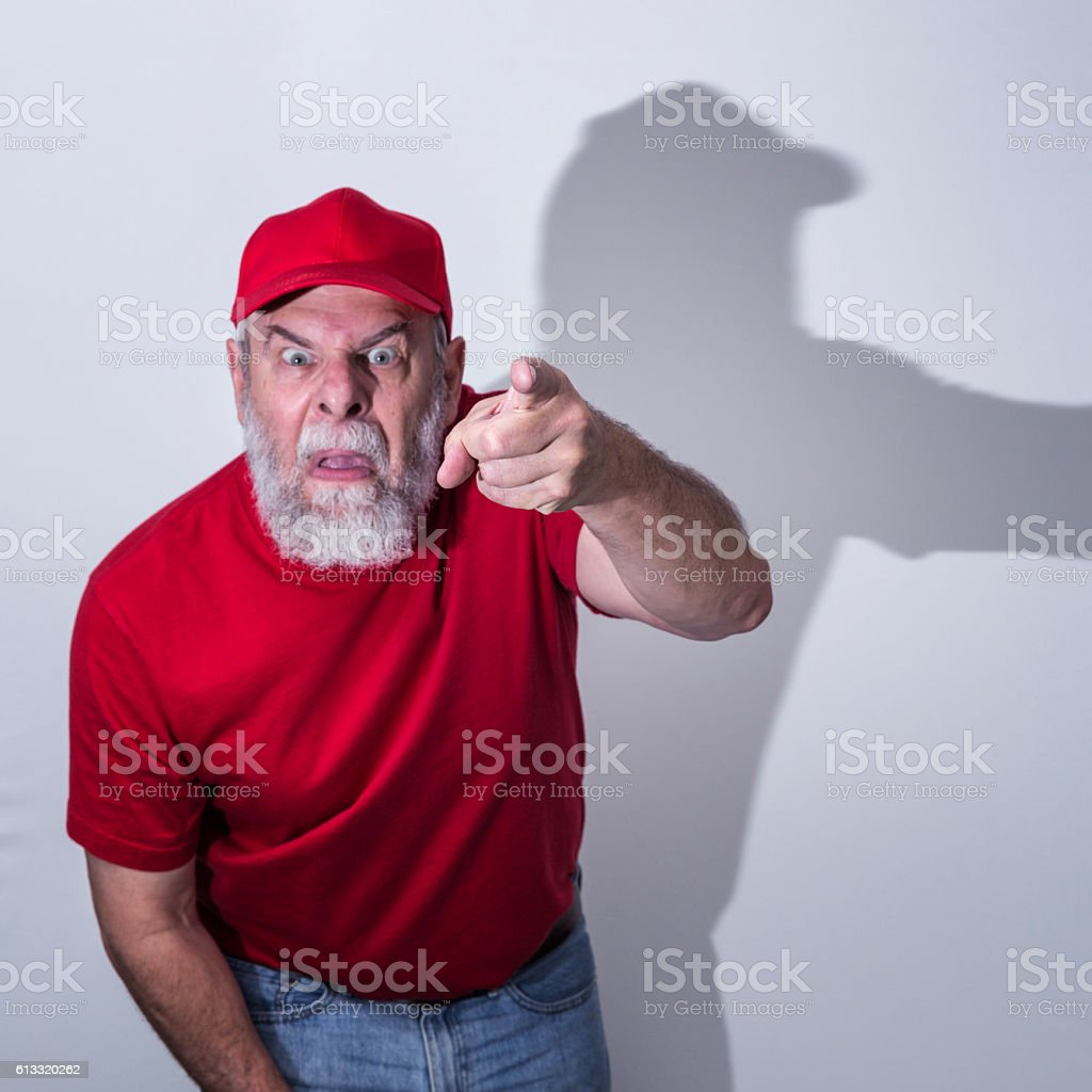 Furious Redneck Hillbilly USA National Election Loser Pointing and Threatening stock photo