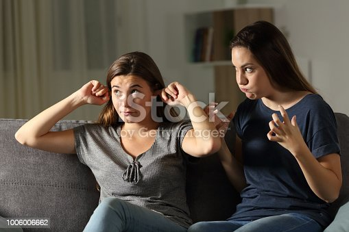istock Furious woman and friend ignoring her 1006006662