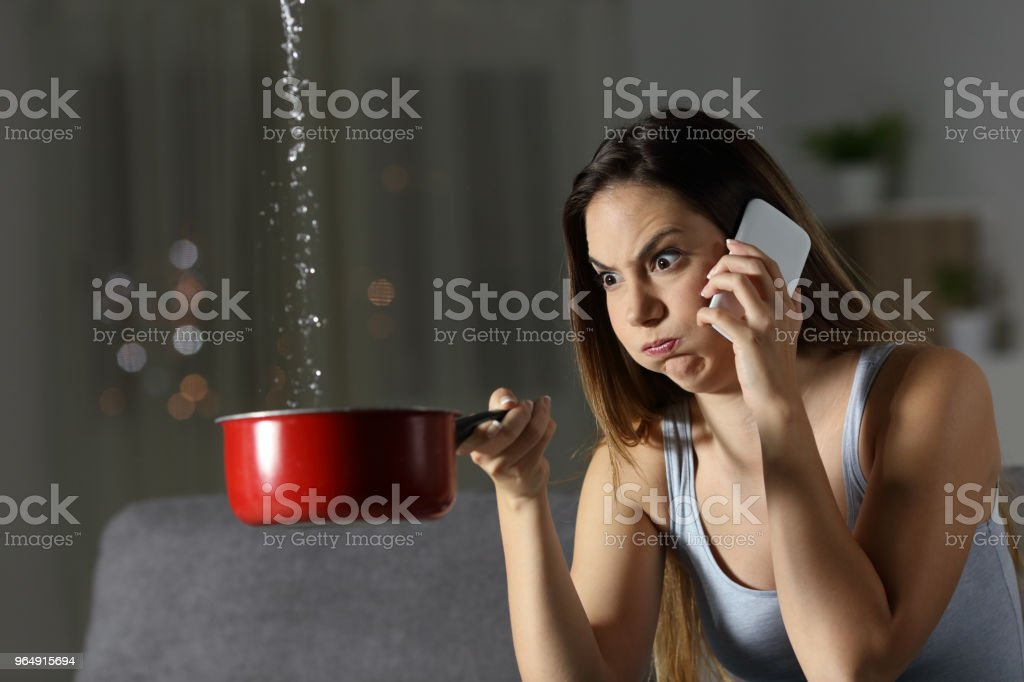 Furious woman claiming insurance for water leaks royalty-free stock photo