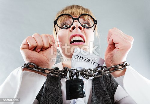 istock Furious woman with chained hands and contract 638992970