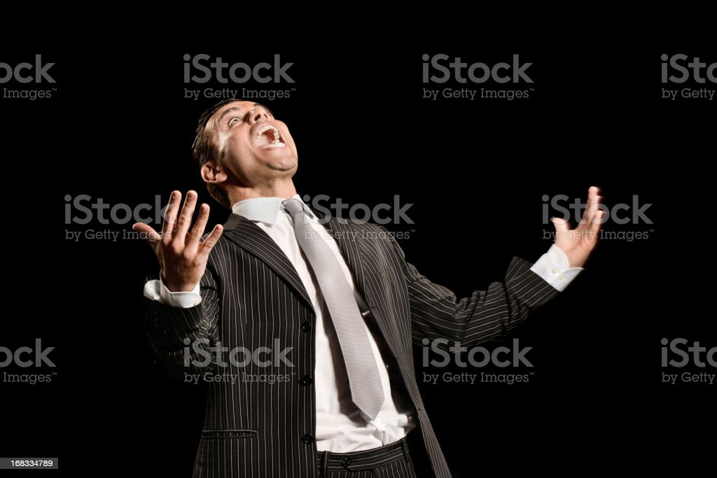 Furious young businessman on black background royalty-free stock photo