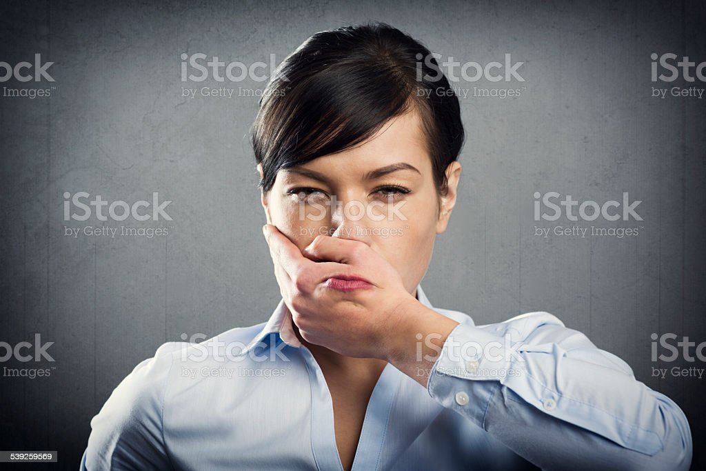 Furious young businesswoman. stock photo