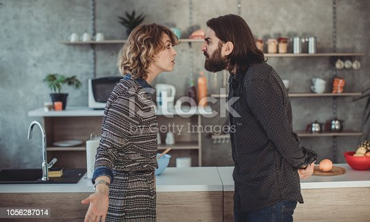 950599040istockphoto Furious young couple shouting 1056287014