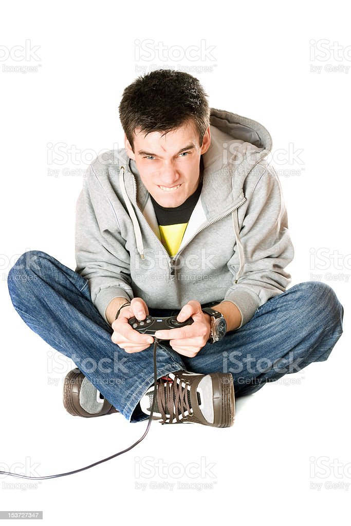Furious young man with a joystick for game console royalty-free stock photo