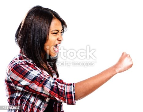 istock Furious young woman shakes her fist and yells 471453837
