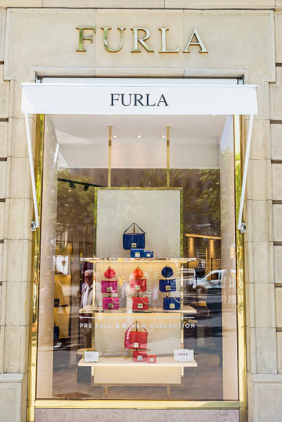 Furla shop, Barcelona Barcelona, Spain - May 25, 2016: Furla shop located on Passeig de Gracia, one of the most expensive streets in Europe. gracia baur stock pictures, royalty-free photos & images