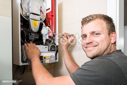 istock Furnace heating maintenance and repair 589554594