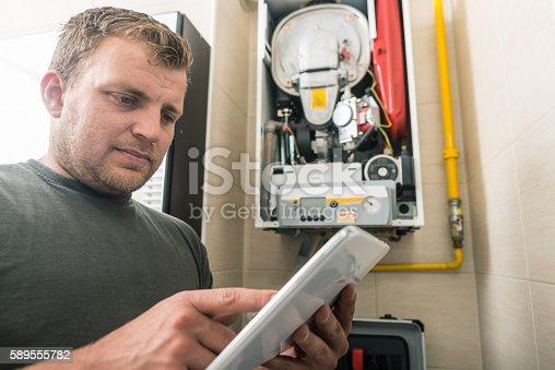 istock Furnace repairman 589555782