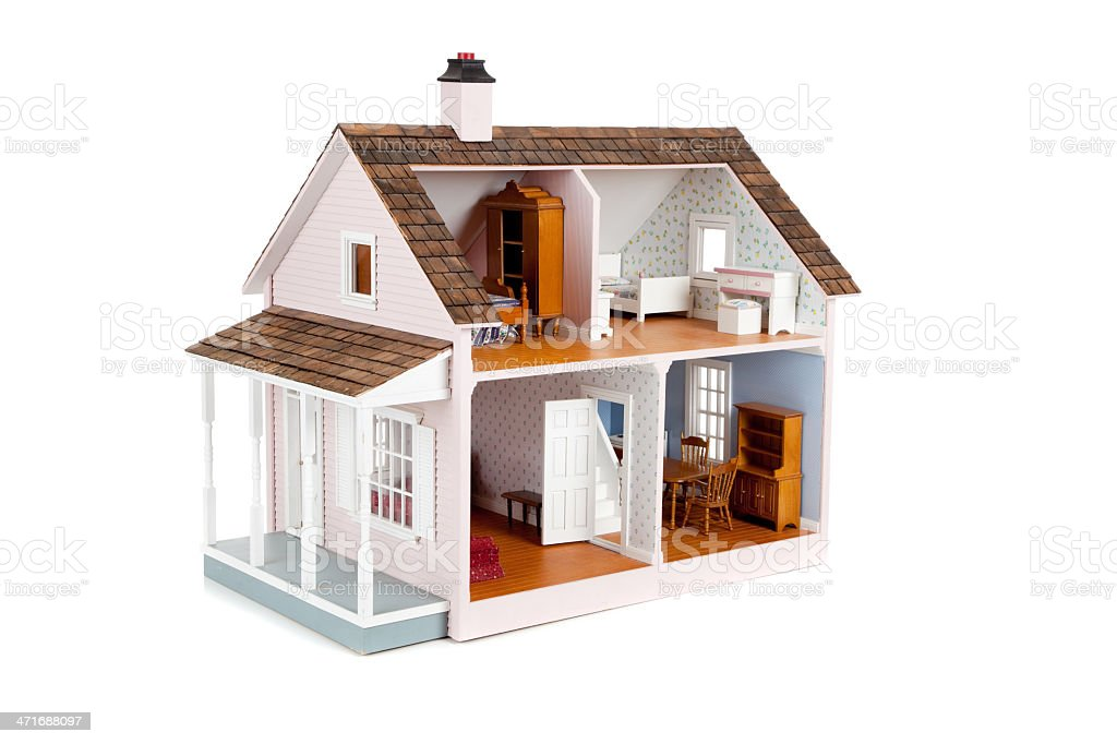 Furnished pink doll house on white stock photo
