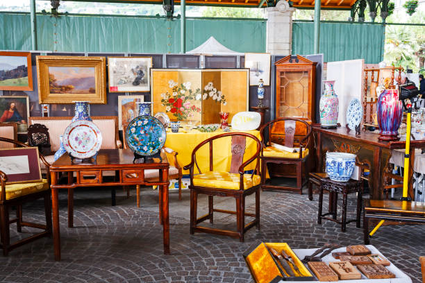 Furniture and paintings on sale at antiques market stock photo