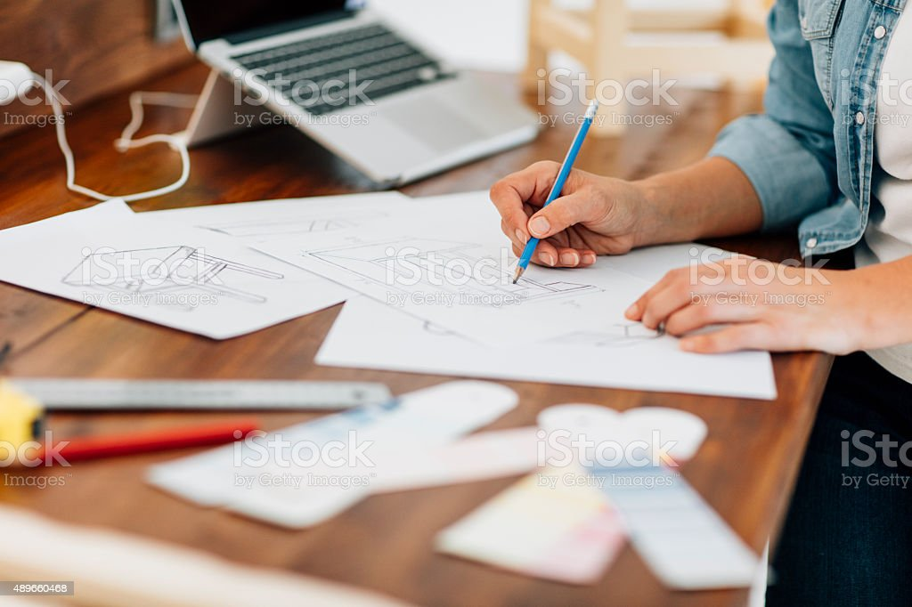 Furniture Designer At Work In Her Workshop. stock photo