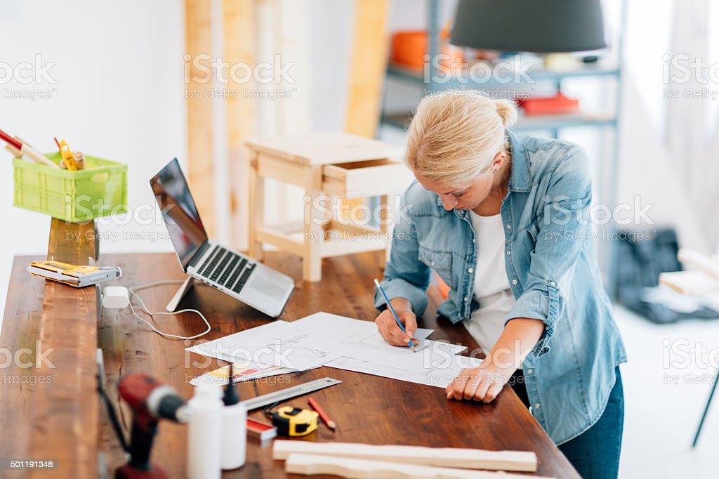 Furniture Designer At Work In Her Workshop. stock photo