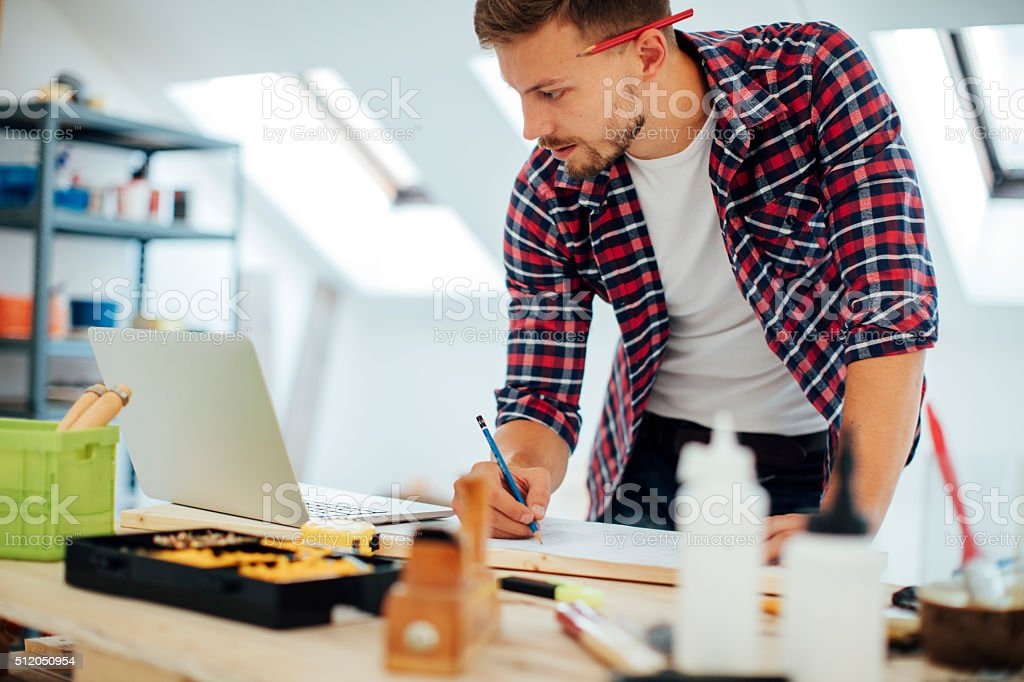 Furniture designer working in office stock photo