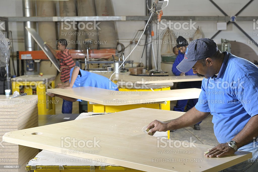 Furniture finishing by hand stock photo