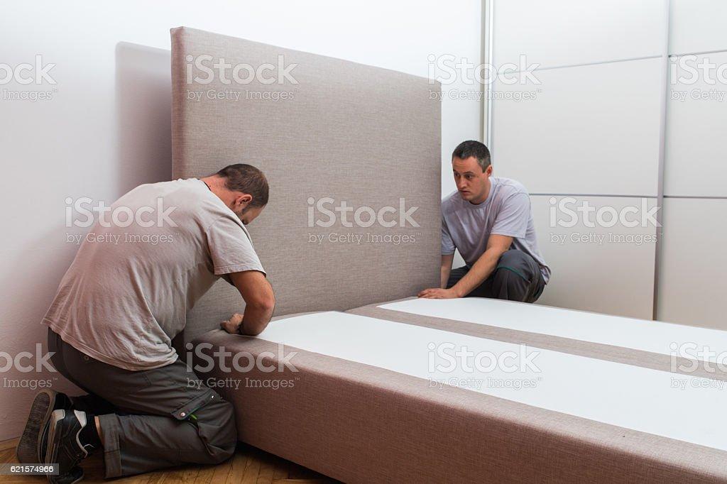 Furniture maker sets bed photo libre de droits