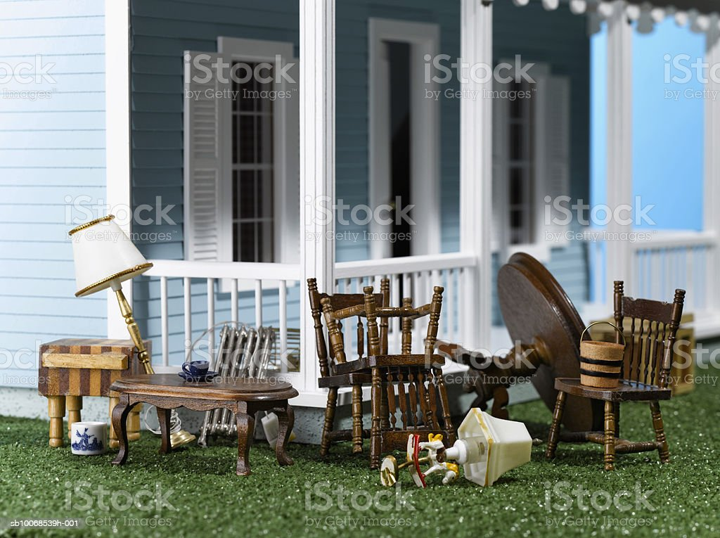Furniture on lawn of model house, close-up royalty-free stock photo